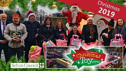 Council staff and volunteers collecting gifts for the 2019 Christmas toy appeal